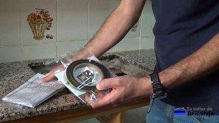 instrucciones y elementos de sujección proporcionados por el fabricante de la nueva placa de cocina