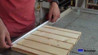 midiendo el largo de la base para cortar los ángulos de aluminio