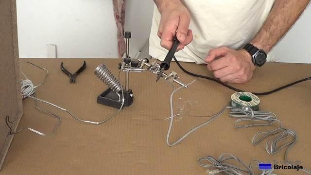 ajustando el termoretractil al cable de audio