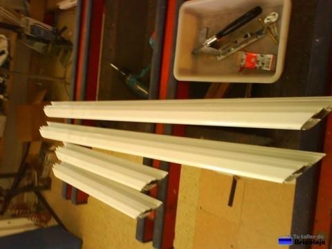piezas que forman la puerta de aluminio